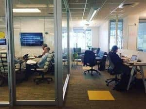 Office workers coworking at NGIN Workplace